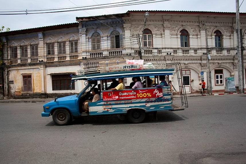 Get with one of the local transports to Phuket Town