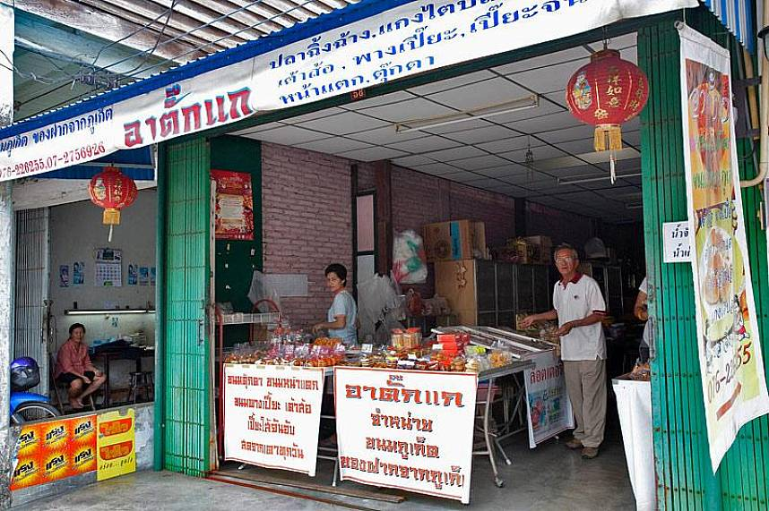Get yourself some local delicacies in one of the small shops at Phuket Town