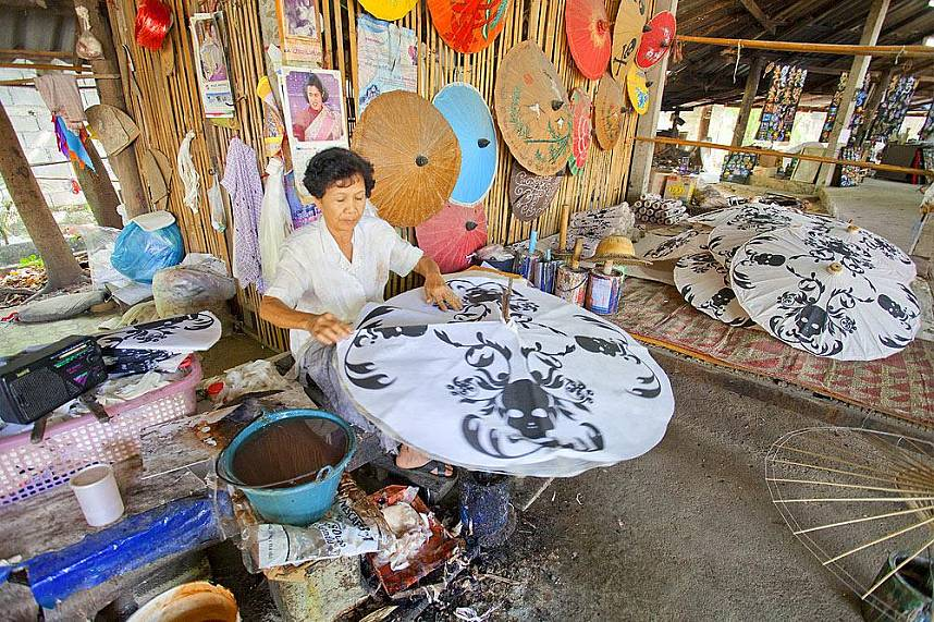 Watch one of the artists at Bo Sang Umbrella Village in Chiang Mai