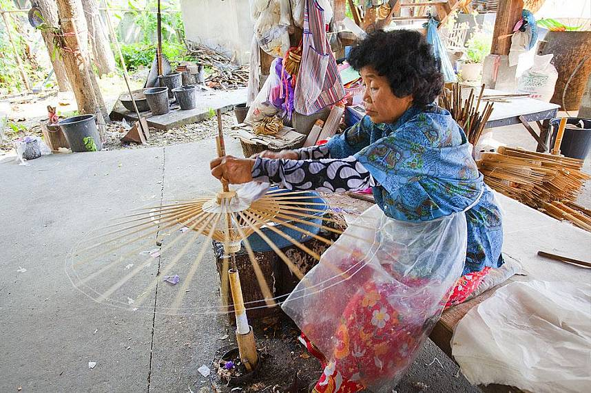 An old lady shows how it is done at Bo Sang Umbrella Village in Chiang Mai