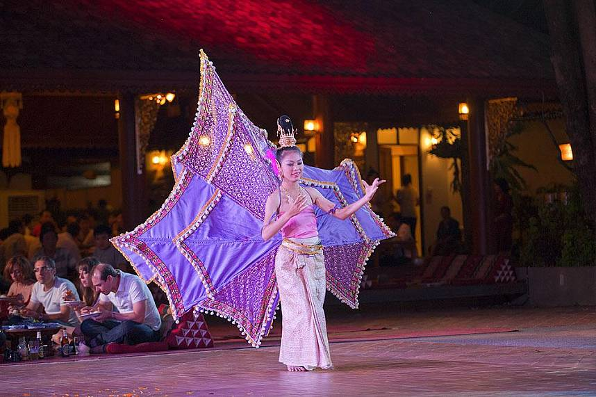 Gracious Thai lady shows a typical North Thailand dance at Traditional Khantoke Dinner and Show