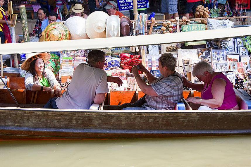 Tourists love a visit at Bangkok Floating Market during their holiday in Thailand
