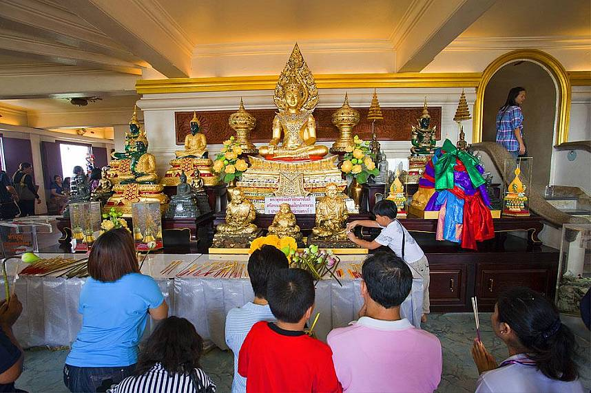 Buddhist worshipers in the temple hall of Wat Saket or Golden Mount Bangkok