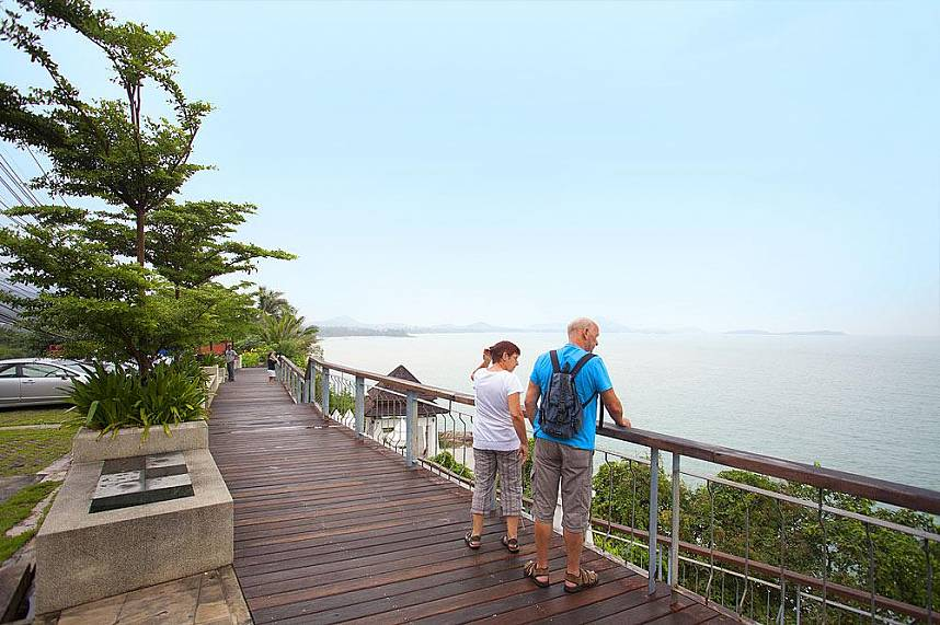 Tourists enjoy the great view from Lad Koh Viewpoint in Samui