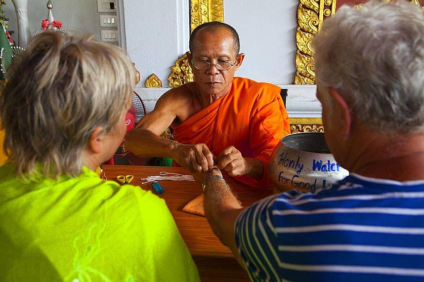 Get yourself a wristband for good luck during a visit to the Mummiefied Monk in Koh Samui
