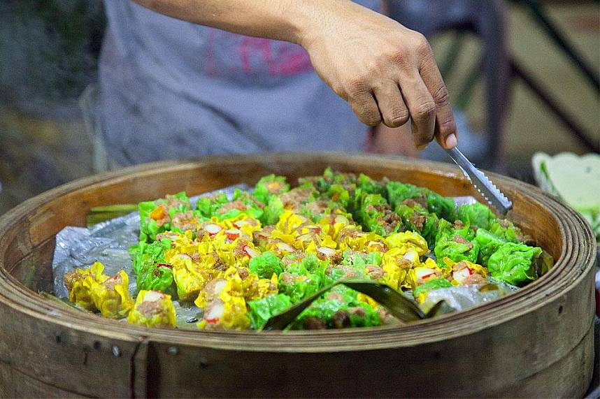 Try some of the local specialties at Maenam Night Market Koh Samui