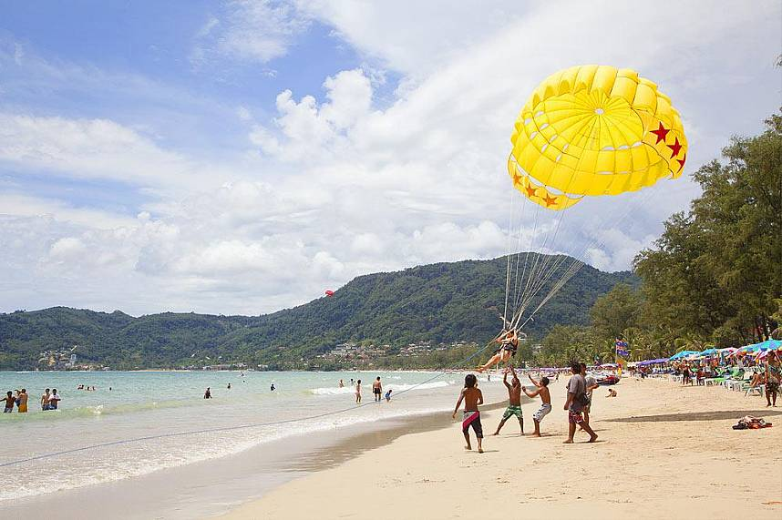 Patong Beach on Phuket sunset coast is famous for its many beach activities