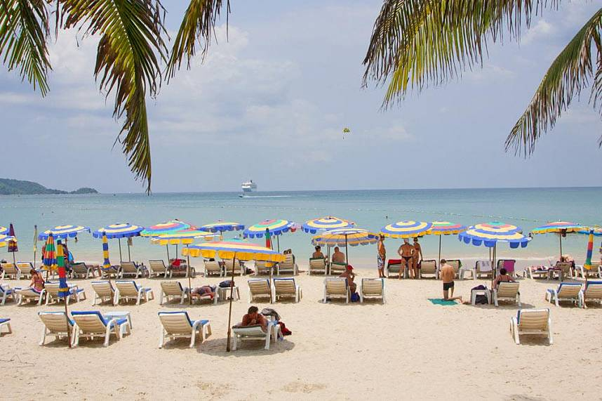 Relax under an umbrella at the most famous Phuket beach Patong