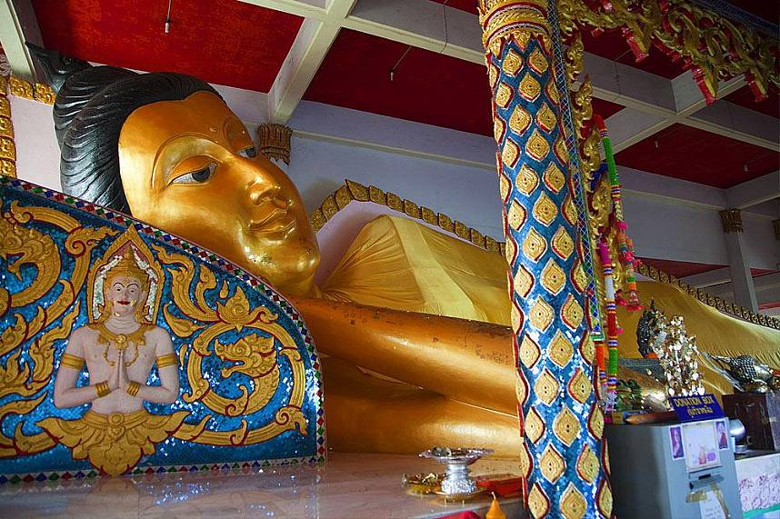 Reclining Buddha at a small temple on Koh Sirey near Phuket