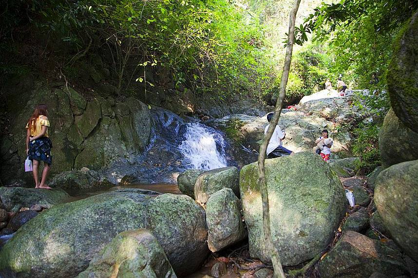 Take a refreshing dip in the natural pool of Nam Tok Chan Ta Then Waterfall
