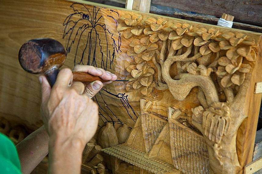 Have a look how the craftsman works at Sudaluck Wood Carving