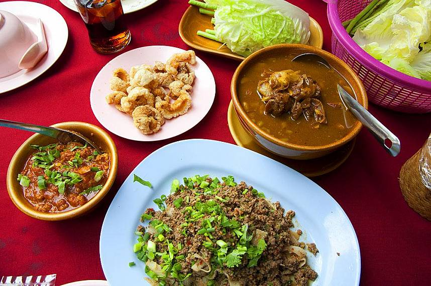 Try a typical North Thailand dinner during your one day trip in Chiang Rai