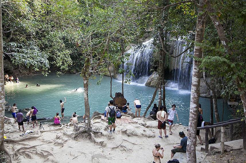 The natural pools at Kanchanaburi Erawan Waterfall are famous for a refreshing bath