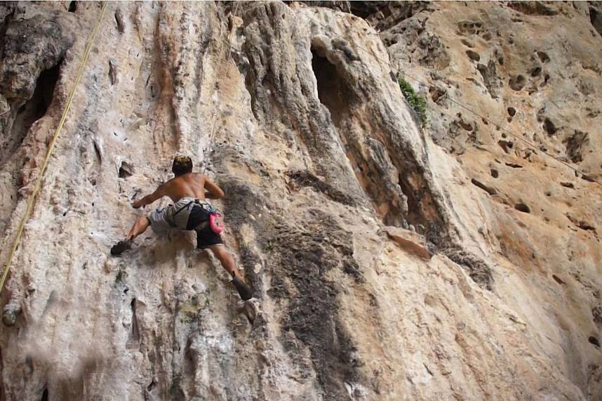 Pure adrenaline adventure during rock climbing at Railay Beach Krabi