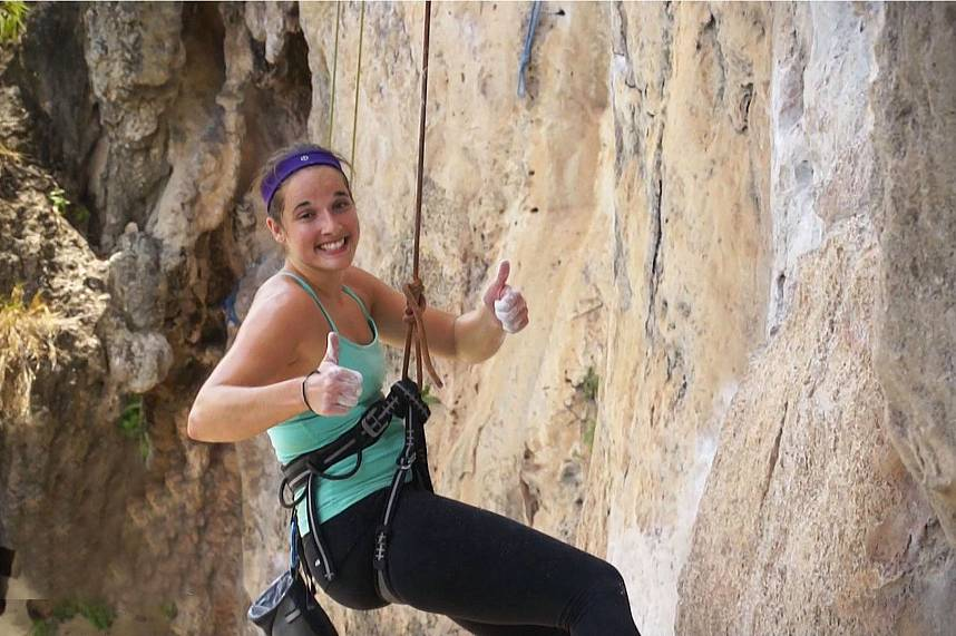 All smiling face while rock climbing at Railay Beach Krabi