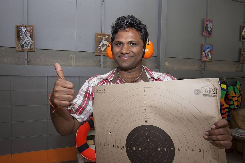 A happy Indian shows his shots at Pattaya Park Shooting and Adventure