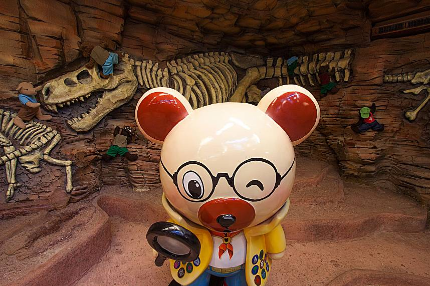 Professor Mouse studies the remains of prehistoric animals at Pattaya Teddy Bear Museum