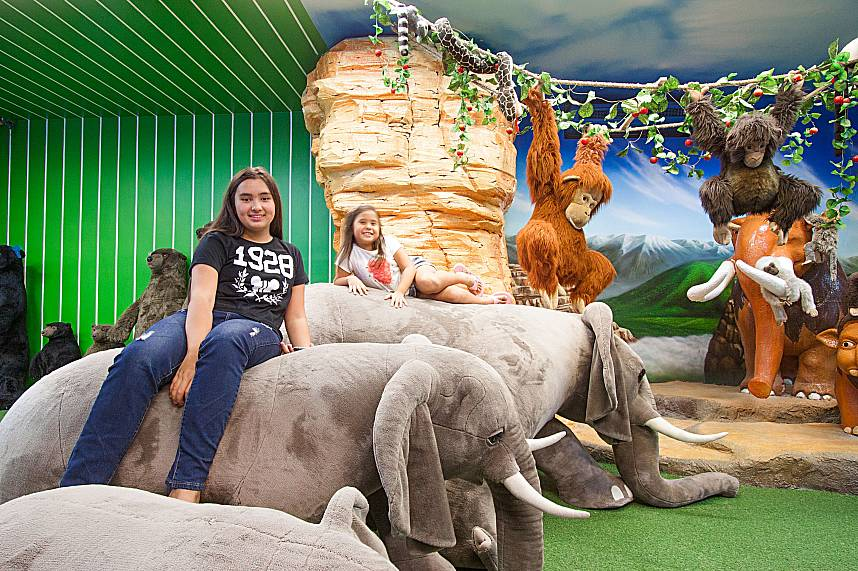 Kids enjoy themselves on the back of huge animated elephants at Pattaya Teddy Bear Museum