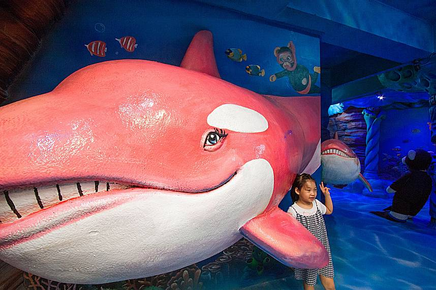 Kids love to take a photo with the smiling dolphin at Pattaya Teddy Bear Museum