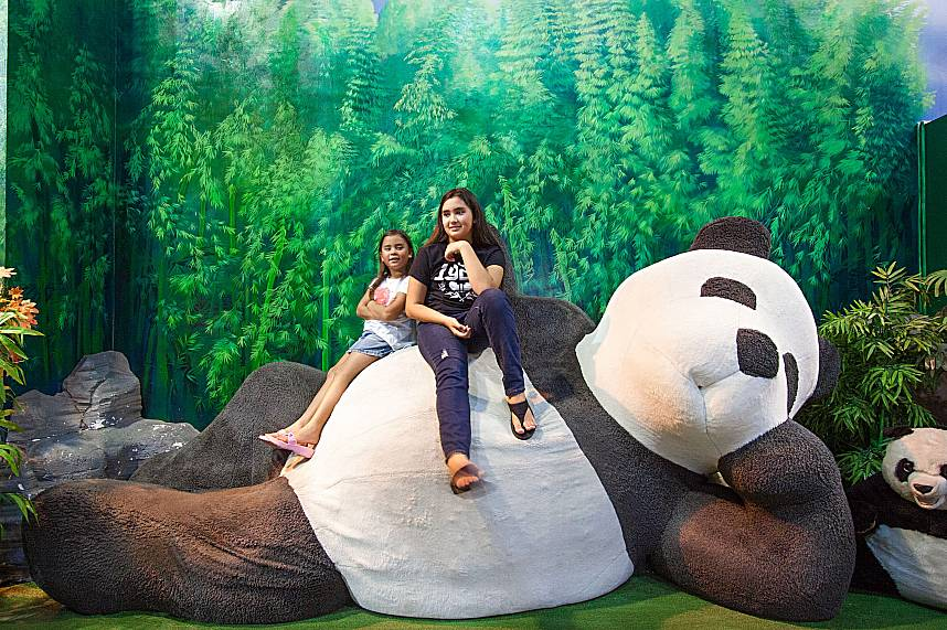A huge reclining cartoon panda at Teddy Bear Museum Pattaya gives a great holiday photo