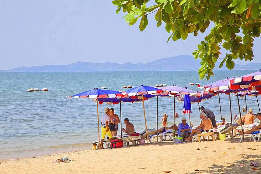 Dong Tan Beach Pattaya provides some sun beds with umbrellas