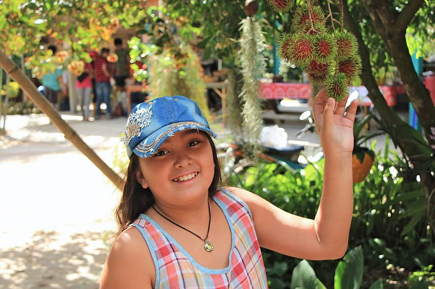 A kid is all smile during a trip to the Rayong Orchards near Pattaya