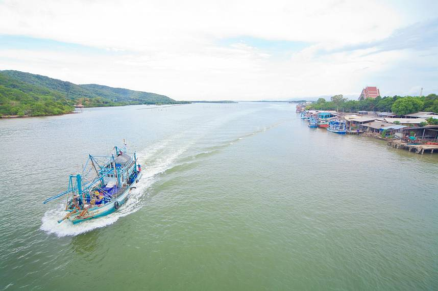 During a rest at Chanthaburi One Day Cycling Trip you can see some fishing vessels