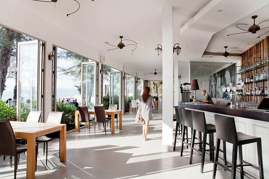 At Bliss Beach Club Bang Tao Phuket you can sit inside or on the terrace by by the beach