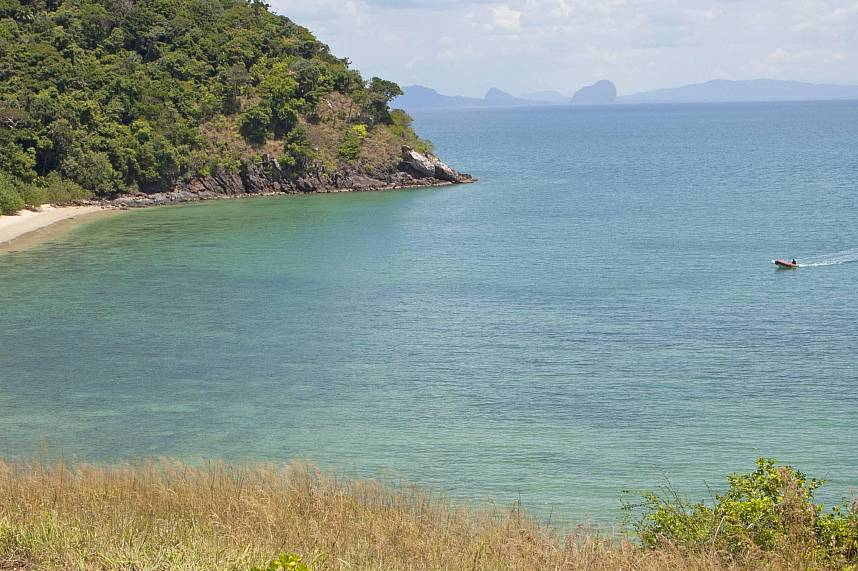 a pristine small beach with clear water at Mu Koh Lanta National Park