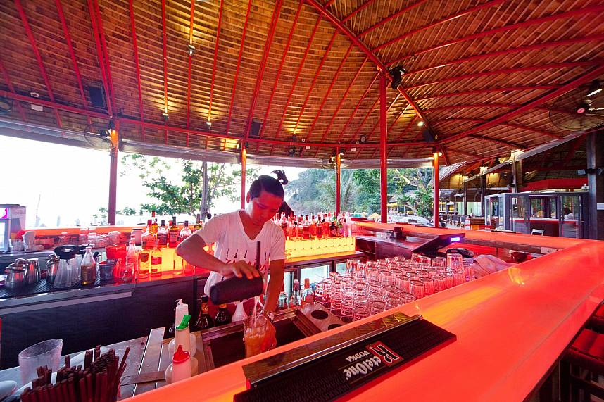 Get yourself an exquisite cocktail from the barman at Zazada Beach Club Phuket