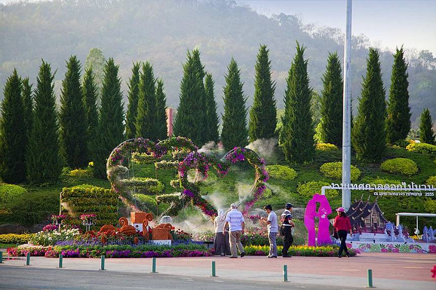 Tourists admire the astonishing flower arrangements at Chiang Mai Royal Flora Ratchapruek Botanical Gardens