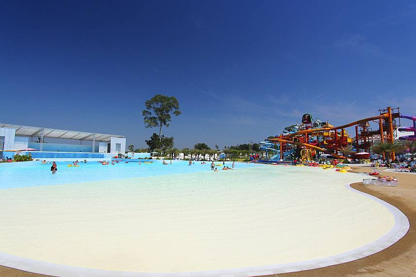 An artificial white sandy beach with a huge pool at Pattaya Water Park Cartoon Network Amazone