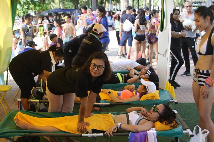 taking advantage of the free massage available for participants