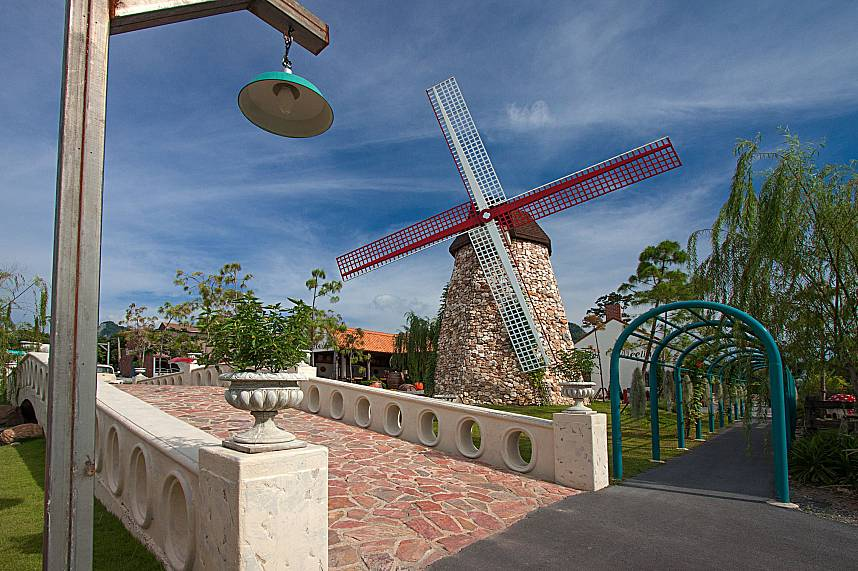 A huge windmill and an old street lamp at Swiss Sheep Farm in Pattaya