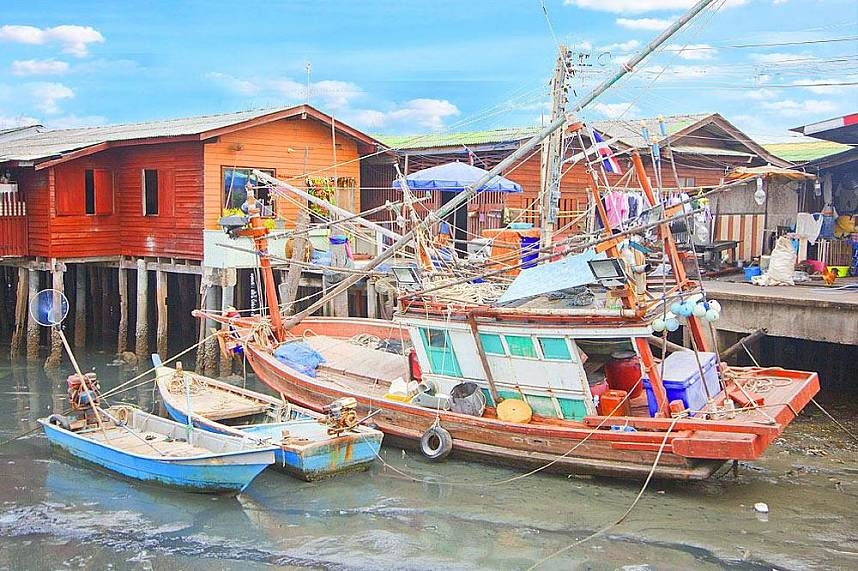 Fishing boats await high tide at Naklua Fish Market North Pattaya