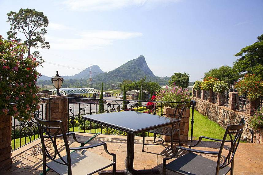 Enjoy a coffee while admiring the picturesque landscape at Silverlake Vineyard Pattaya