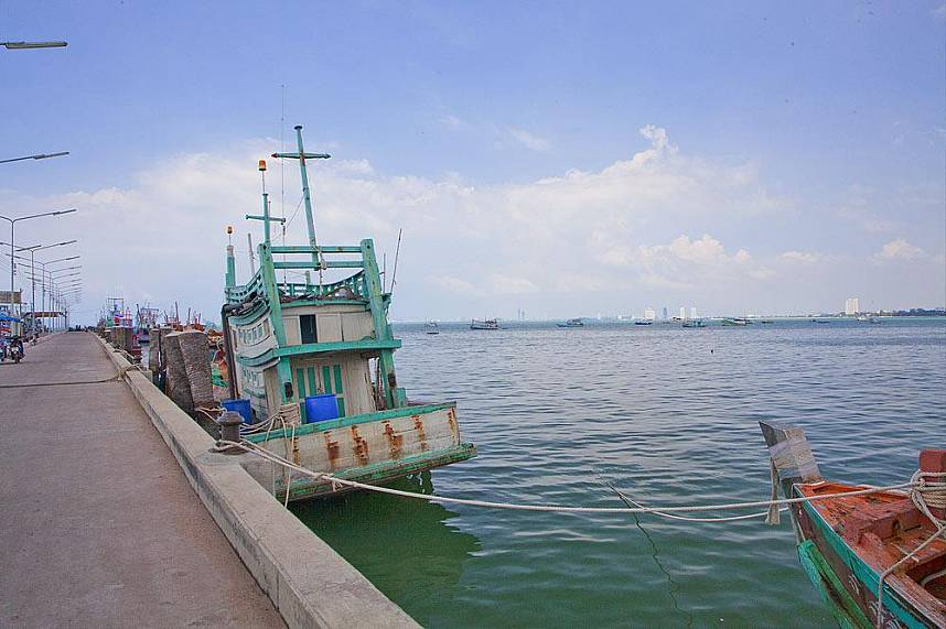 fishing boat at the pier of Bang Sarae Beach Pattaya