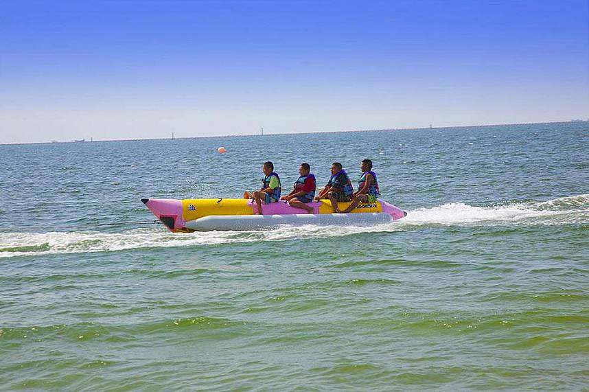 Enjoy a banana boat ride at Bangsaen Beach near Sriracha