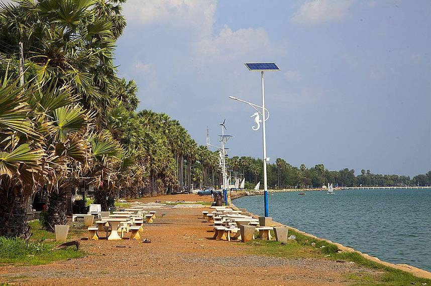 The shoreline of Dongtan Beach Sattahip is covered with palm trees