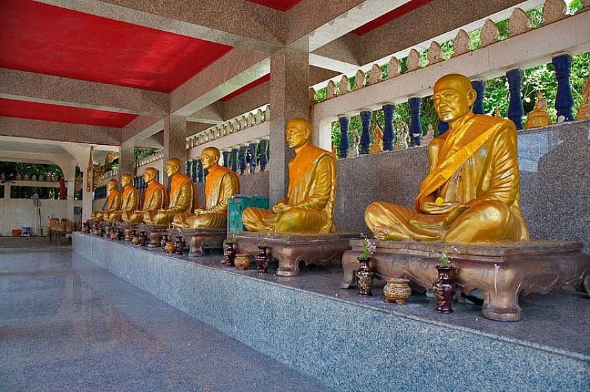 Beautiful sculptures of monks at Patong Temple Wat Suwan Khiri Wong Phuket