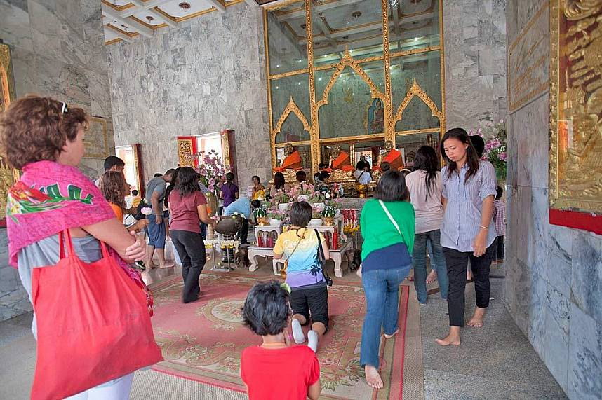 Thais come to pray at Wat Chaitararam Phuket