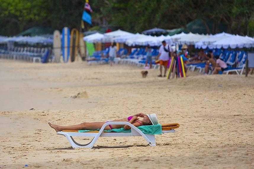 Get a sun tan or relax under an umbrella at Surin Beach Phuket