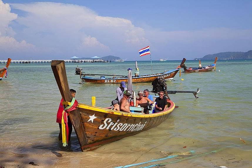 visit from Rawai Beach Phuket with a traditional longtail boat the nearby islands