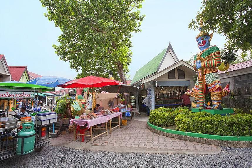 Get a local snack at Big Buddha Temple Koh Samui