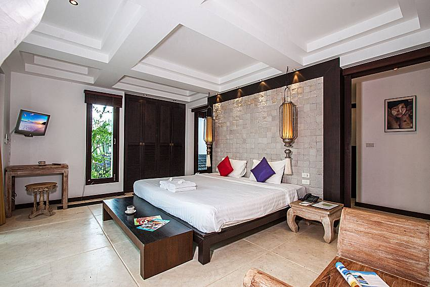 Bedroom with sofa of Niranon villa 22