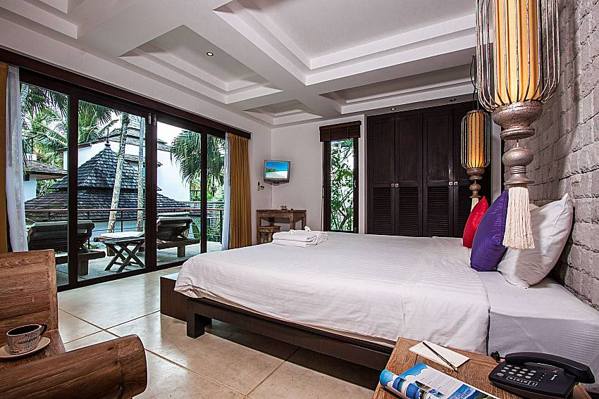 Bedroom with phone of Niranon villa 22