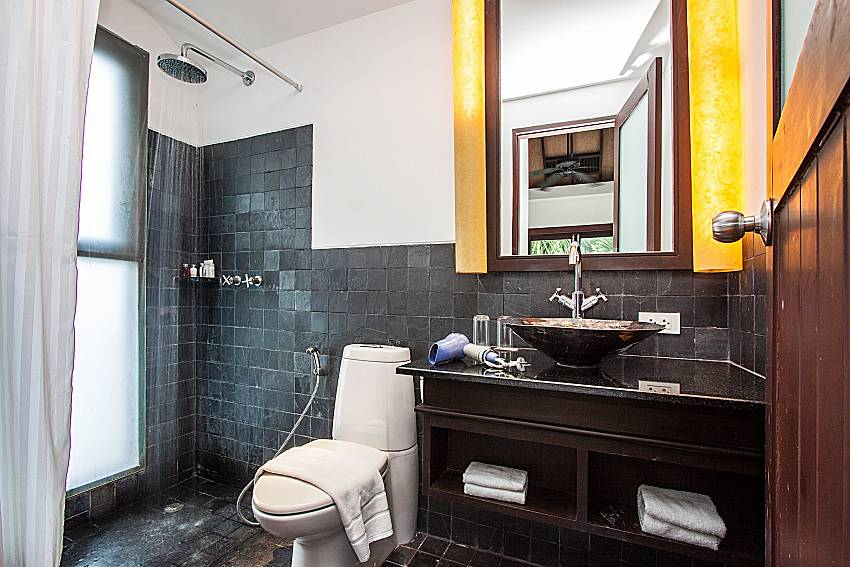 Bathroom with shower and toilet of Niranon villa 22