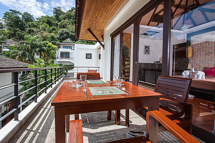 Dinning table on balcony of Nirano villa 14