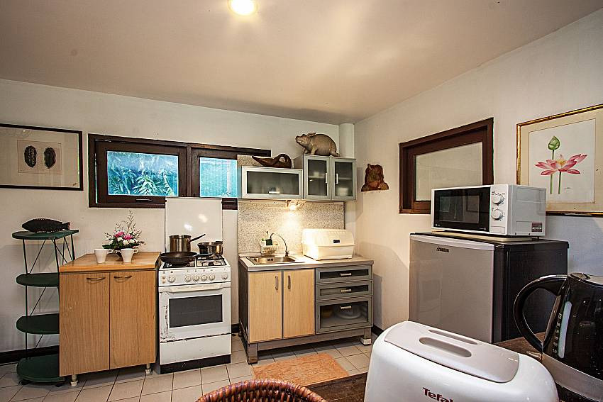 A kitchen with a refrigerator and microwave of Ruean Jai A