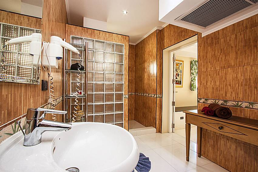 Bathrooms are tiled wood adorned with beautiful lamp of Pratumnak Argyle Villa